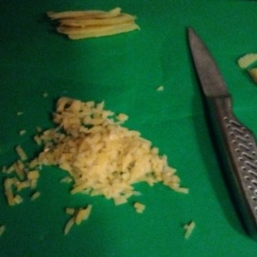 Slicing and dicing boiled lemon peel. | Image courtesy of Sam Collenette