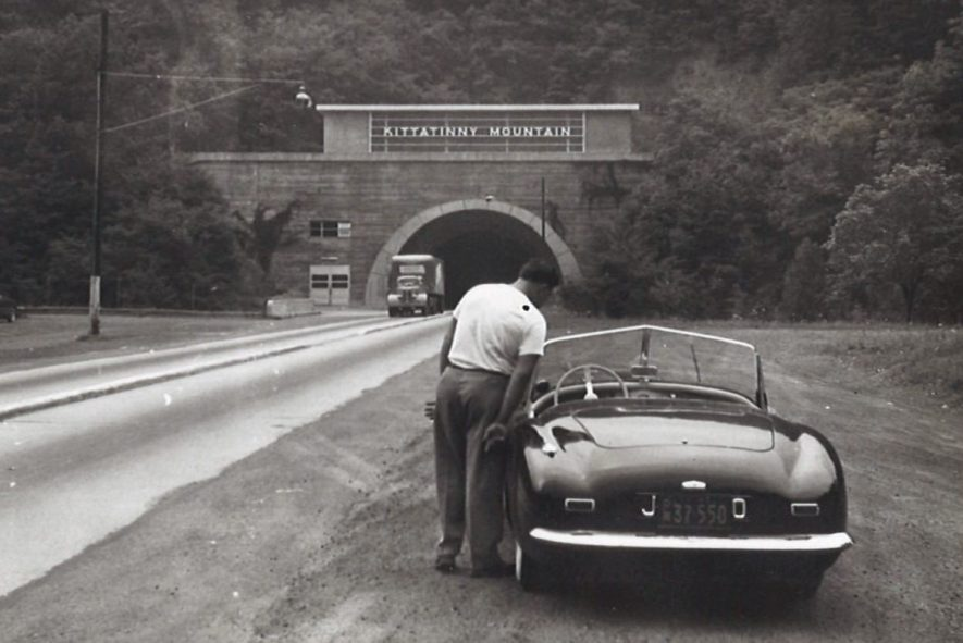 Rear view of prototype Nash Healey [JWD 300] with American plates (37 550) parked near Kittatinny Mountain road tunnel. [c.1949-1950] | Warwickshire County Record Office reference CR4804/2/221