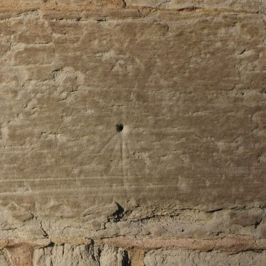 An old sundial on one of the exterior church walls. Scratch dials or Mass Dials were used when a stick was inserted into the centre to use the sun to tell the times to celebrate mass. | Image courtesy of Caroline Irwin