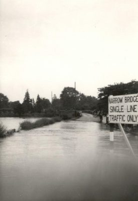 The bridge at Wolston flooded, 1970s.