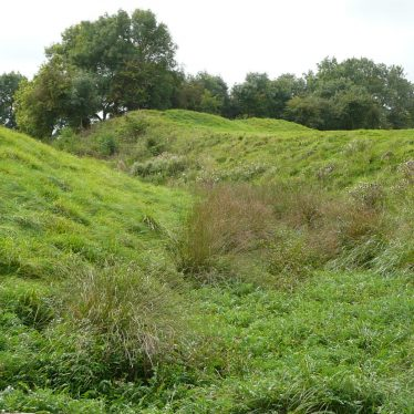 View of the embanked bailey, showing ditch around the motte. | Image courtesy of William Arnold
