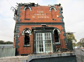 Fire-damaged Great Western Pub, Station Road Warwick. Two storey, semi-derelict red-brick building with french doors and arched windows, roof has gone and downstair windows have gone and upstair ones are bricked up; bracket for sign (but sign has gone). | Image courtesy of Anne Langley