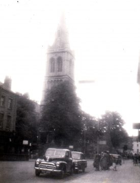 St Andrew's in Rugby, 1950s.A Morris(?) car is in the foreground, behind which is the tower and spire of the church. | Image courtesy of Godfrey Holter