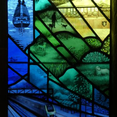 Train and canal in bottom left of window. Church of St Mary, Lapworth | Image courtesy of Adam Pearce