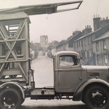 Eagle Engineering. Cherrypicker. A lorry has some extendable metal frames on the back, in the down position. | Image courtesy of Susan Dyke