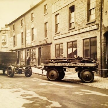 'The Eagle Haulage Trailer'. A trailer is attached to a lorry, emerging from an engineering site. | Image courtesy of Susan Dyke