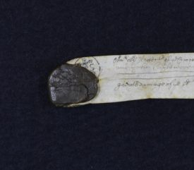 The seal may have some detailing on it, including a cross, but it is very difficult to see. | Warwickshire County Record Office reference CR173/7