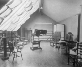 Photograph of interior of James Speight's photography studio, upstairs workroom [Sutton Coldfield], showing camera centre room, c.1908 | Warwickshire County Record Office reference CR4781/165