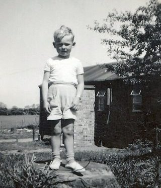 Me, standing on a tree stump. 1950s. | Image courtesy of Ian Burgess