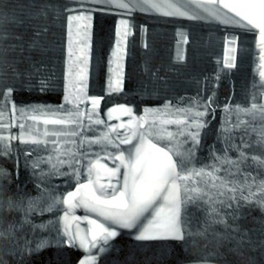 My Dad holding my brother as a baby. 1950s. | Image courtesy of Ian Burgess