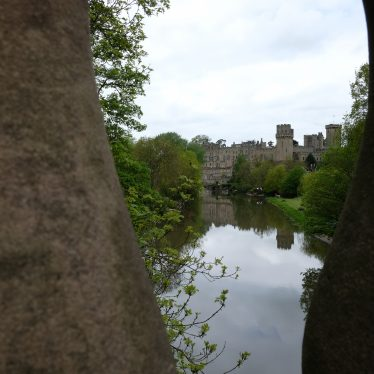 View from Castle Bridge, Warwick, 2018. Warwick Castle in the background with River Avon in foreground | Image courtesy of John Woodland