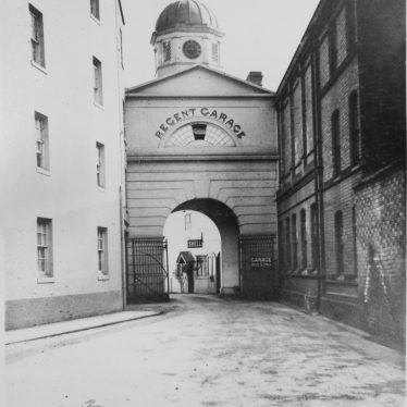 Photograph of Regent Garage entrance archway with clock cupola, c.1920s | Warwickshire County Record Office reference CR4014/191