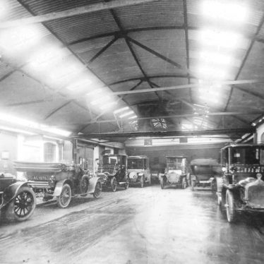 Photograph of Regent Garage interior including Wolseley-Siddeleys, namely a Landaulette and Phaeton, 1913 | Warwickshire County Record Office reference CR4014/191