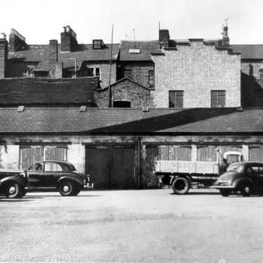 Photograph of Regent Garage yard, 1956 | Photograph by Courier Photographic Services, courtesy of the Leamington Courier. Warwickshire County Record Office reference CR4014/192