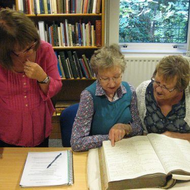 Researching the names in Warwickshire County Record Office. | Image courtesy of Unlocking Warwick