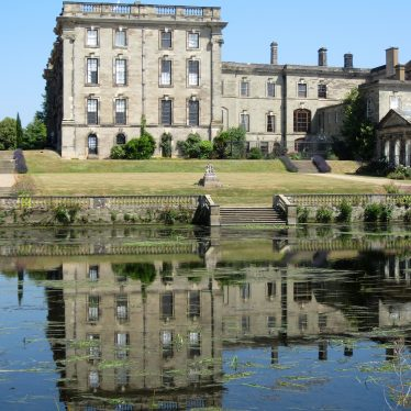 Stoneleigh Abbey reflected in the Avon, 2018. A Georgian 4-storey building with lawns down to lake | Image courtesy of Anne Langley