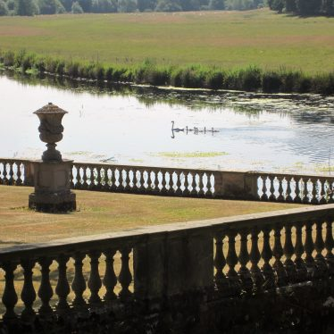 Swan family on the Avon at Stoneleigh. Balustrades and urn with swan and 5 cygnets on river beyond | Image courtesy of Anne Langley