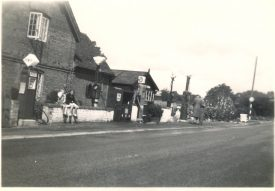 The filling station at Haseley, August 1950. A petrol pump with a riangular sign is in front of a house-type structure, that joins immediately onto the road. | Image courtesy of RT Bolton. Warwickshire County Record Office reference B.HAS.Bol(P)