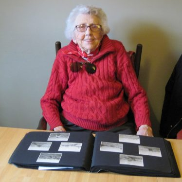 Joan Broscomb with her photo album, 2018. | Image courtesy of Valerie Harman