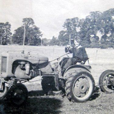 Bickmarsh. Sam Lynes on the Allis Chalmers tractor at Bickmarsh Hall Farm.