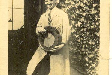 Wroxall. Leonard Bolton at Wroxhall Abbey Holding Gear Wheel