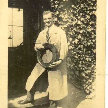 Wroxall. Leonard Bolton at Wroxhall Abbey Holding Gear Wheel