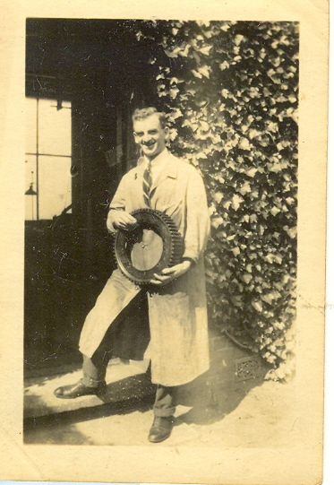 Wroxall. Leonard Bolton at Wroxhall Abbey holding the large gear wheel of a car, c.1920 | Image courtesy of RT Bolton