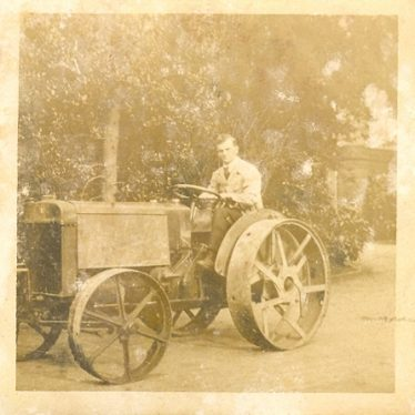 Wroxall. Leonard Bolton Driving an Austin Tractor at Wroxhall Abbey