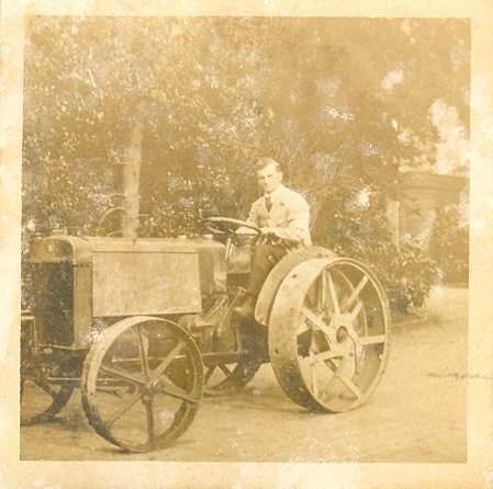 Leonard Bolton driving an Austin tractor at Wroxhall Abbey, c.1920 | Image courtesy of RT Bolton