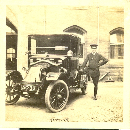Chauffeur with Renault car registration AC 32 at Wroxhall Abbey, c.1920 | Image courtesy of RT Bolton