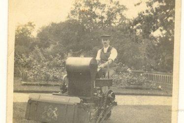 Wroxall. Gardener Using Large Petrol Powered Lawn Mower, Wroxhall Abbey