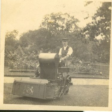 Wroxall. Gardener Using Large Petrol Powered Lawn Mower, Wroxhall Abbey