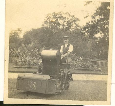 Gardener using large petrol powered lawn mower, Wroxhall Abbey, c.1920 | Image courtesy of RT Bolton