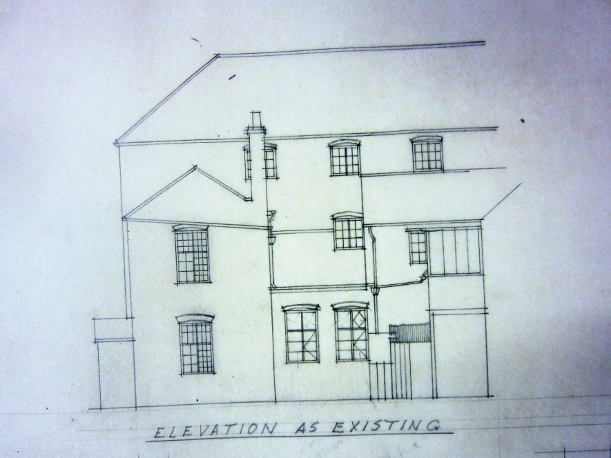Former Meriden Workhouse building in 1952. Architect's drawing of front elevation of 3-storey building with 2-storey extension, porch, pitched roof, windows and external drainpipes | Warwickshire County Record Office reference CR1535, County Architect's drawing
