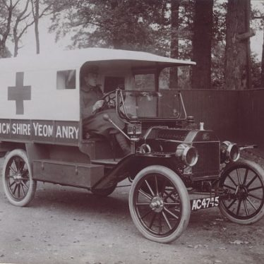 Geoffrey Gibbs driving a Warwickshire Yeomanry ambulance | Image courtesy of Leamington Spa Art Gallery & Museum