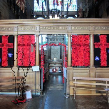 Entrance decorated with poppies and WWI model soldier | Image courtesy of Anne Langley