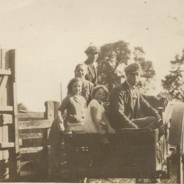 Ladbroke.  Family in Farm Cart