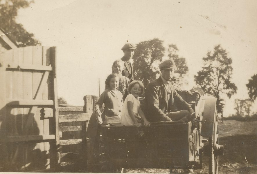 Ladbroke. Jo Lowrie's Great Uncle George with family in cart behind the farm, early 20th century. | Image courtesy of Jo Lowrie