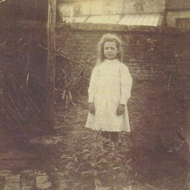 Ladbroke.  Child outside Church Cottages.