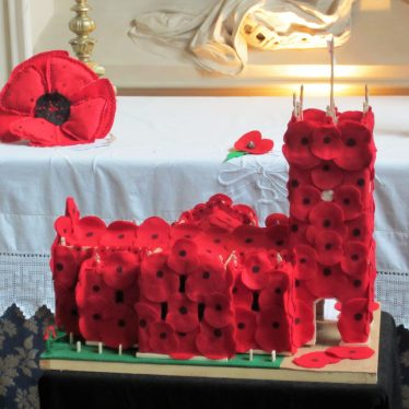 Model of St Mary's church, Warwick, with tower covered in red poppies; tombstones in churchyard outside, November 2018 | Image courtesy of Anne Langley