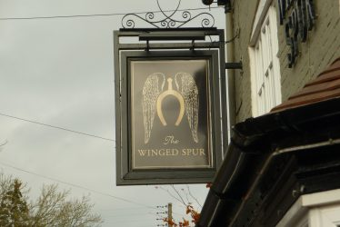 Why Did the Winged Spur Pub Get Its Name?