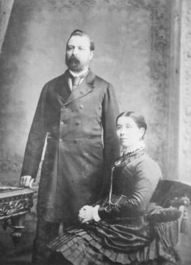 Photograph of Thomas Potterton and his wife, seated, 1880 | Photographer C. Hawkins. Potterton, Boiler Manufacturers collection, Warwickshire County Record Office reference CR4765/164
