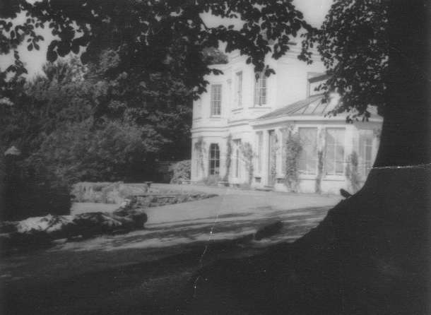 Black and white view of the garden and house at Cliffe Hill, 1960s - early 1970s. | Image courtesy of Kevin Moloney