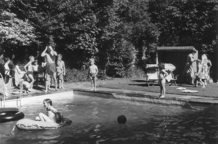 Children's party at Cliffe Hill. Mr Butterworth used to host summer parties for local children in the swimming pool at the far end of the garden. 1960s - early 1970s. | Image courtesy of Kevin Moloney