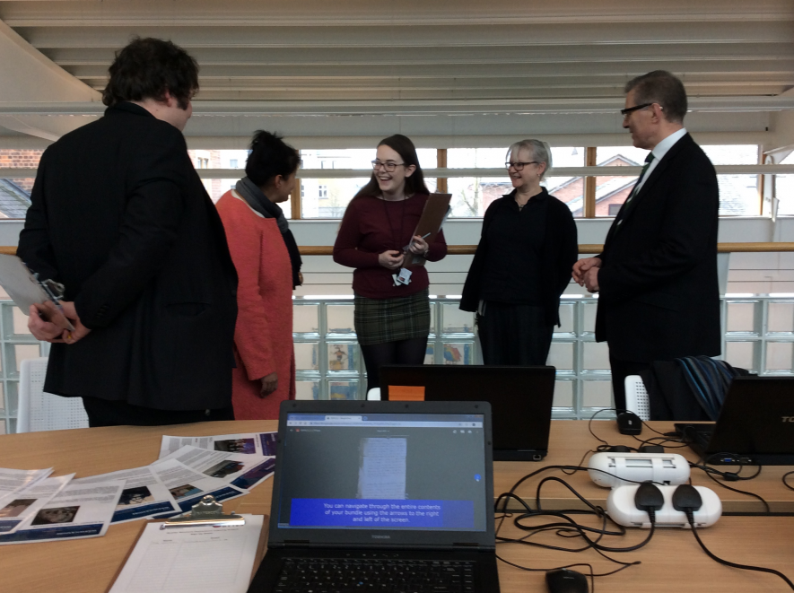 Suzannah (centre) with other members of the Warwickshire Bytes team at Rugby Library, talking to Kam Kaur, WCC Cabinet Portfolio Holder for Customer and Transformation, and Mark Pawsey MP. | Image courtesy of Sarah Hann