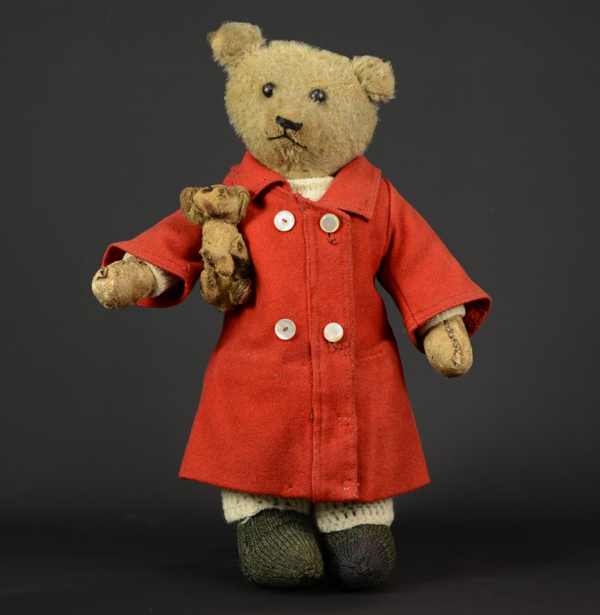 Teddy and Fifi soft toy, c.1910-1920. Bear holding small dog under arm. | Image courtesy of Warwickshire Museum