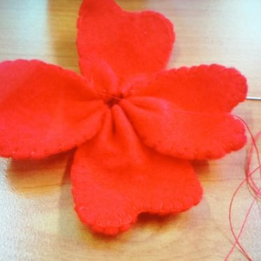 A near finished poppy with four red petals sewn together | Image Courtesy of Lynne Hodgson