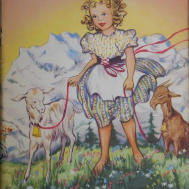 A colourful front cover for the classic children's book Heidi. Heidi is a young girl in a dress with two pet goats for which she is holding leads. The title is at the top of the cover, and the author is at the bottom. | Image Courtesy of Fern Hodges