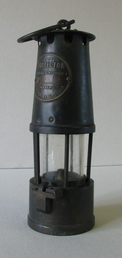 Cylindrical metal and glass miner's lamp | Image courtesy of Warwickshire Museum