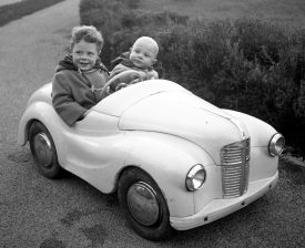 Taking my brother for a spin in my Austin J40 pedal car, now missing its fenders and hood ornament | Image courtesy of Jonathan Kinghorn